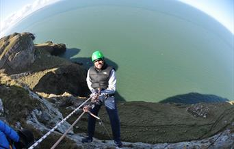 Man abseiling down Great Orme